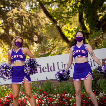 Cheer team welcoming students to campus