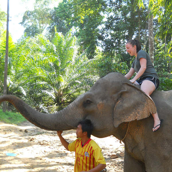 student riding an elephant