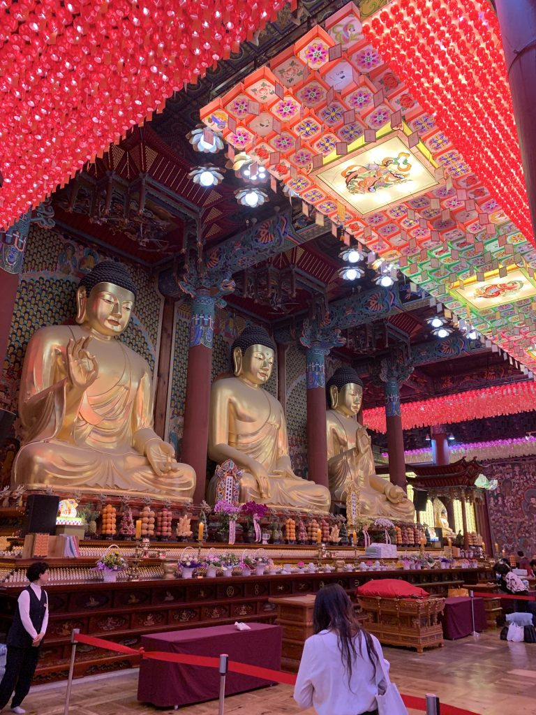 Three Buddha statues