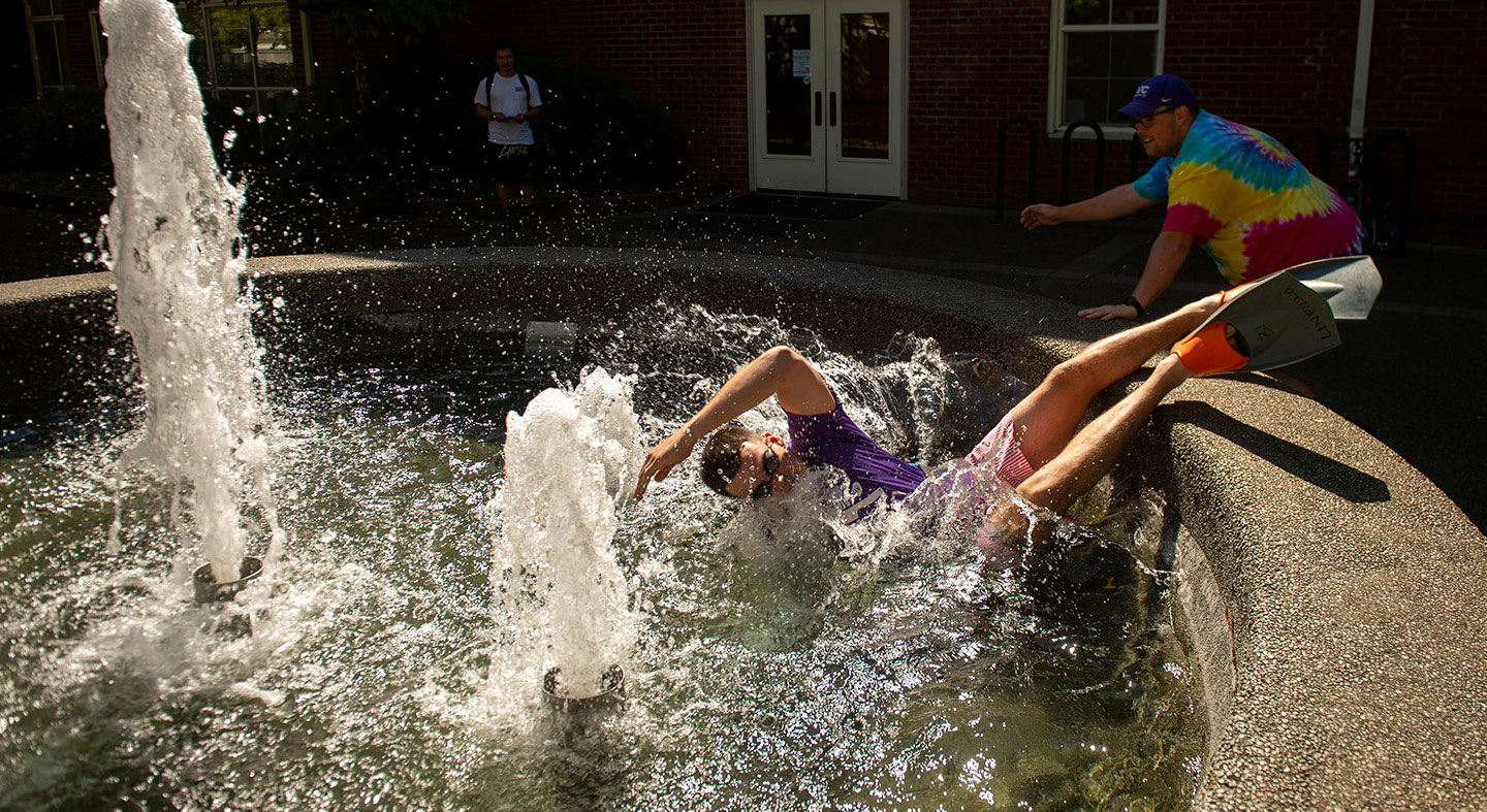 student swim in the fountain